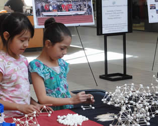 Children building marshmallow structures at Engineers at the Mall event on Feb 26, 2012