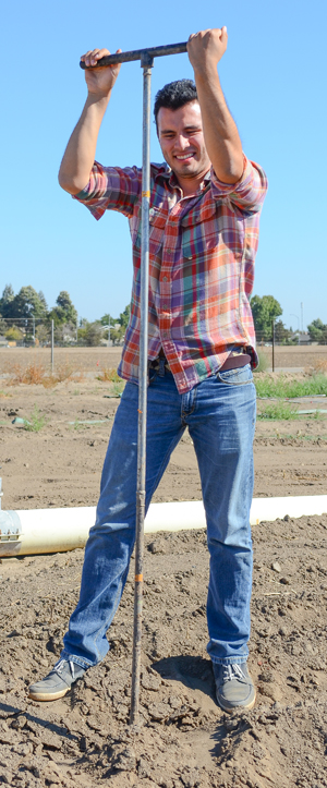 Student taking soil samples on Fresno State farm
