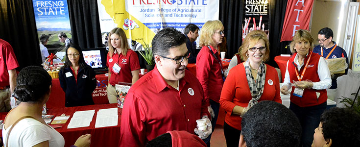 President Joseph & Mary Castro & Interim Dean Sandra Witte at Fresno State booth at World Ag Expo