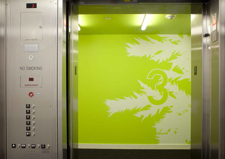 Elevator doors and green wall