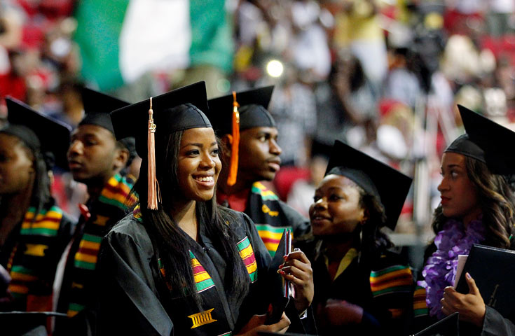 African American female student smiling during ceremony