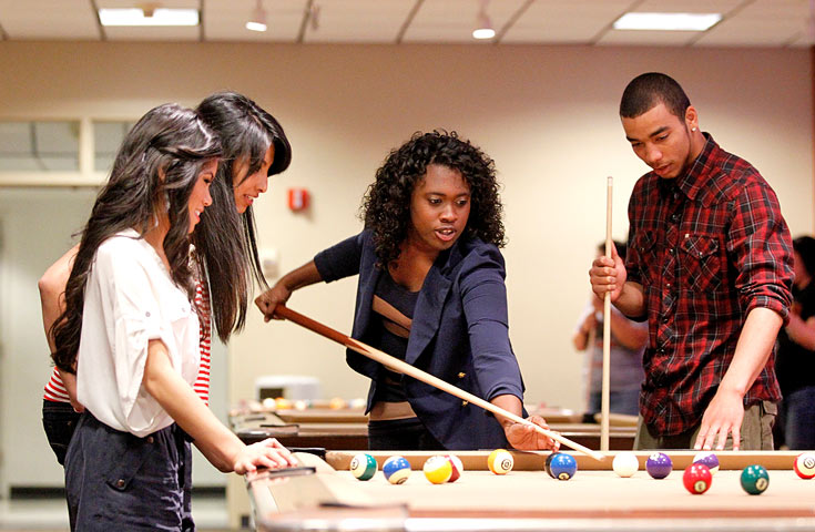 Students playing pool at the Bulldog Bowl